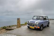 Portugal - Classic Car Road Trip: Our own classic Mini next to the zero kilometre signpost of the Route of Santiago de Compostela at Cape...