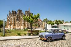 Portugal - Classic Car Road Trip Portugal: The classic Mini in the town of Batalha in front the Monastery of Batalha. In 1385, the town was the...