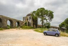 Portugal - Classic Car Road Trip Portugal: The Mini Authi in front of the inspection building of the Pegões Aqueduct, the largest and most...