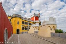 Portugal - Classic Car Road Trip Portugal: The Pena National Palace, built on the ruins of a monastery. King Ferdinand II of Portugal transformed a...