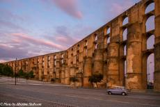 Portugal - Classic Car Road Trip Portugal: Our own classic Mini looks very tiny next to the 16th century Amoreira Aqueduct in Elvas. The huge aqueduct...