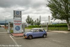 Portugal - Classic Car Road Trip: The Mini Authi at the gates of the former plant of the Authi Car Company at Pamplona in Spain. The...