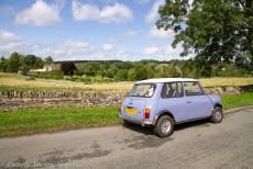 IMM 2019 Bristol - Classic Car Road Trip: Driving through the Cotswolds in our own classic Mini, Upper Slaughter Manor in the background. The gardens include a lake,...