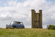 IMM 2019 Bristol - Classic Car Road Trip: The Mini Authi in front of the Broadway Tower, a folly on Broadway Hill in the village of  Broadway. The twenty...