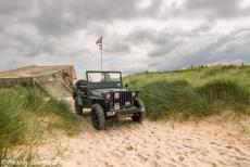 Normandy 2014 - Classic Car Road Trip Normandy: Our own WWII Ford Jeep on Juno Beach, a German bunker of the Atlantic Wall in the background. Juno Beach is one of...
