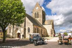Normandy 2014 - Classic Car Road Trip Normandy: Our own WWII Jeep in front of the Church of Sainte-Mère-Église, a copy of a paratrooper hanging...