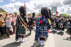 Normandy 2014 - Classic Car Road Trip Normandy: A Scottish bagpipe and drum band on the Pegasus Bridge at Ranville as part of the 70th...