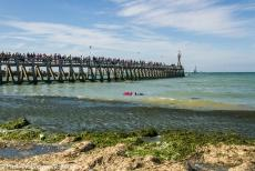 Normandy 2014 - Classic Car Road Trip Normandy: Courseulles-sur-Mer, a floral wreath floating on the waves near Juno Beach Pier during a...