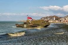 Normandy 2014 - Classic Car Road Trip Normandy during the 70th anniversary of D-Day: A DUKW floating on the sea in front of Juno Beach at Courseulles-sur-Mer. In...