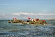 Normandy 2014 - Classic Car Road Trip Normandy, the 70th anniversary of D-Day: DUKWs floating on sea within sight of Juno Beach at Courseulles-sur-Mer. A...