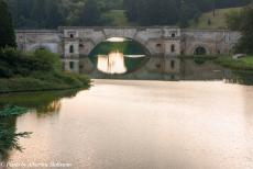 Longbridge IMM - Classic Car Road Trip: The Queen's Pool and the Grand Bridge at Blenheim Palace, the water from the Queen's Pool flows under the bridge to...